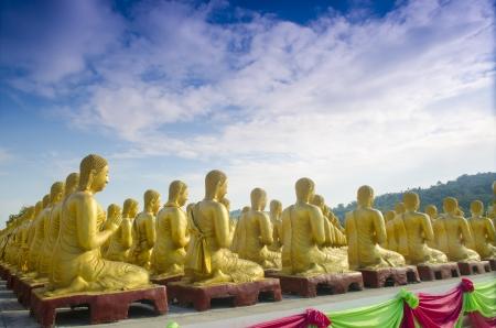 Makha Bucha, buddha with 1250 disciples statue, Nakhonnayok, Thailand photo