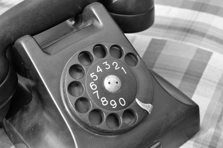 Old black phone in black and white,vintage style photo