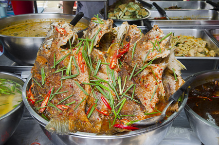 chili's restaurant: Freshly prepared Thai style whole fish red snapper dinner with tamarind sauce