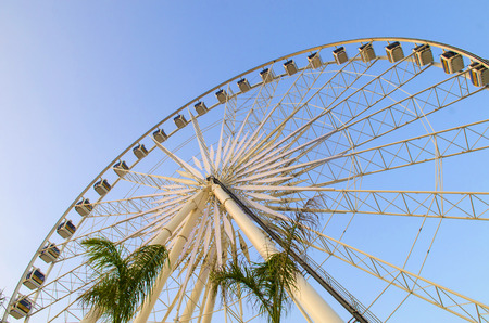 Beautiful large Ferris wheel. And the blue sky. photo