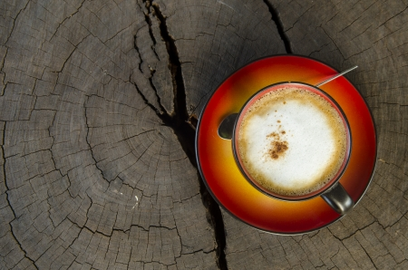 cup of art coffee on the wood  photo