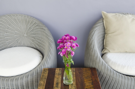 Chairs and flowers in coffee shop photo