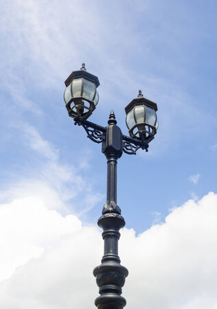 the vintage lamp with cloud blue sky photo