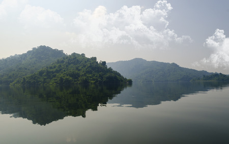 Reflections of tropical forest on the Lake photo