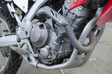 Motorcycle engine closeup at field of racing photo