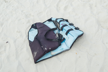 A life jacket on a beach