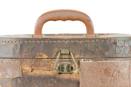 Vintage brown suitcase isolated over white background photo