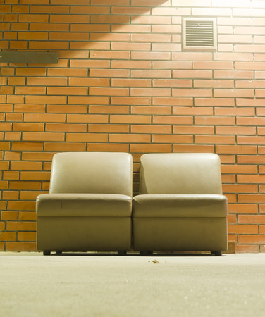 vintage sofa with brick wall background and light photo