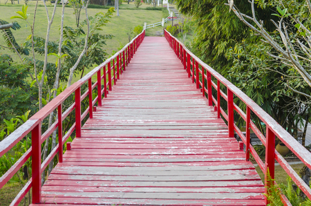 A red wooden bridge long and beautiful. photo