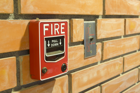 Fire alarm switch for the security system in the building. Foto de archivo