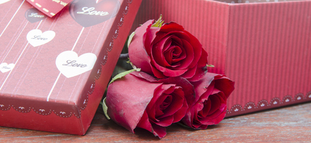 love concept of roses and gifts for Valentines Day. photo