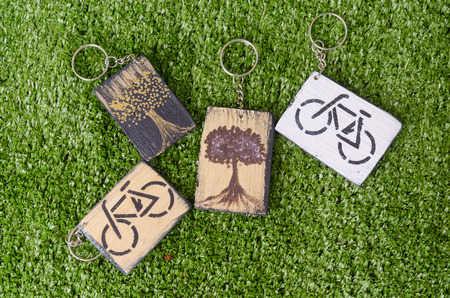 Wooden keychain engraved on the environment. photo