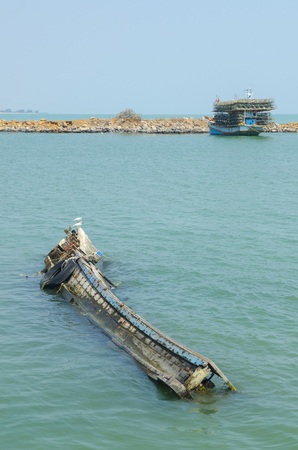 The Sea fishing boat sank at petchaburi province ,Thailand photo