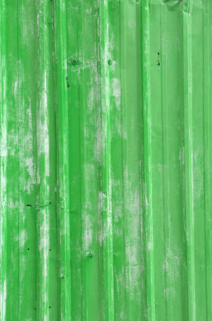 Rusty corrugated iron metal fence Zinc wall texture background, Green color photo
