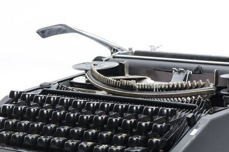 type writer: Antique typewriter against a crisp white backdrop. Stock Photo