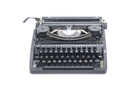 Antique typewriter against a crisp white backdrop. photo