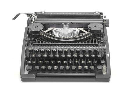 Antique typewriter against a crisp white backdrop. photo