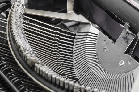 Close up of antique typewriter typebars with focus on the at symbol, great concept for blogs, journalism, news or the mass media photo
