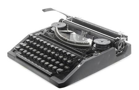 crisp: Antique typewriter against a crisp white backdrop. Stock Photo