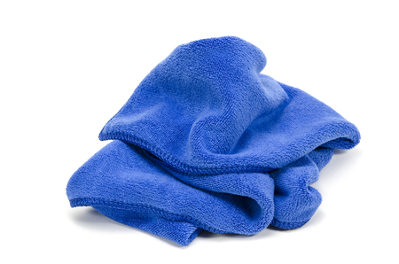 Crumpled blue microfiber cloth isolated on white background photo