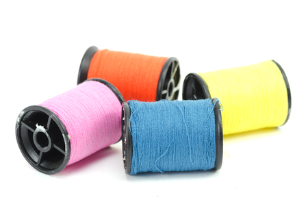 colorful sewing Threads isolated on white background photo