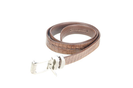 vintage belt made from crocodile skin isolated on white with clipping path photo