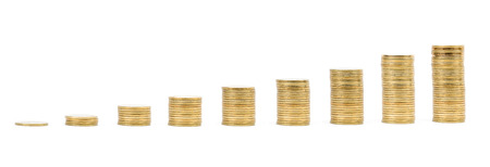 Savings, increasing columns of gold coins isolated on white background photo