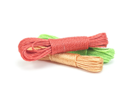 string together: bundles of colorful nylon ropes on white background Stock Photo