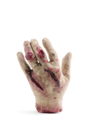 amputated: Red hand amputated, halloween decoration detail, realism and fear, violence Stock Photo