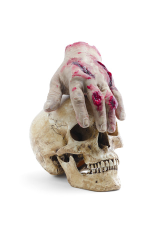 Red hand amputated with human skull, halloween decoration detail, realism and fear, violence photo