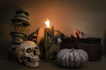 Still life with skull, old lamp, pumpkin and candle photo