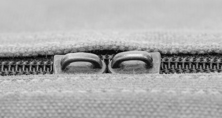 Closeup of zipper on old fabric jean texture photo