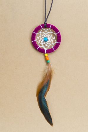 colorful dreamcatcher on brown vintage background photo