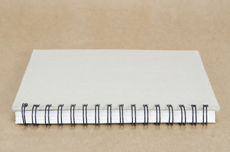 notebook on brown background photo