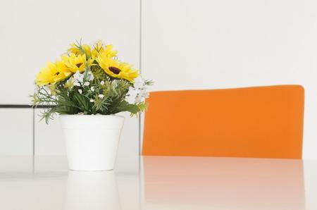 flower in vase on desk photo