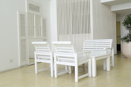 vintage chair and table in front and cages photo