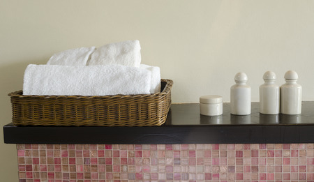close-up basket of pure white spa towels photo