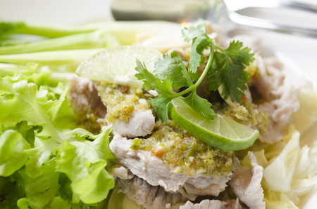 Steamed pork with spicy sauce and lemon photo