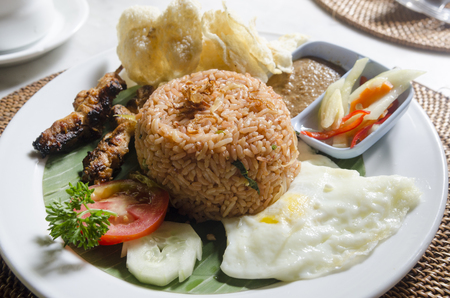 nasi lemack style dish fresh vegetables nuts and fish with rice popular across indonesia and malyasia photo
