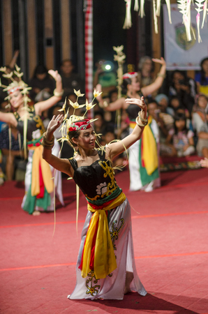 DENPASAR, BALI, INDONESIA - JUNE 14: Unidentified dancer from the indigenous Borneo people performs a traditional Borneo dance at Bali Art Festival on June 14, 2014 in Denpasar, Indonesia