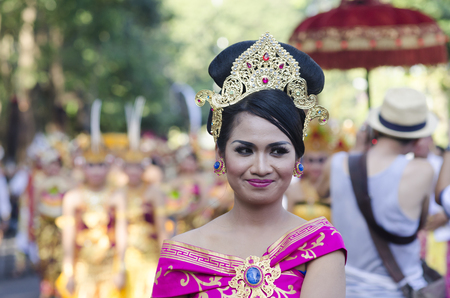 DENPASAR, BALI, INDONESIA - JUNE 18: Unidentified dancer of Balinese in colorful dresses variety on the parade at Bali Art Festival on June 18, 2014 in Denpasar, Indonesia