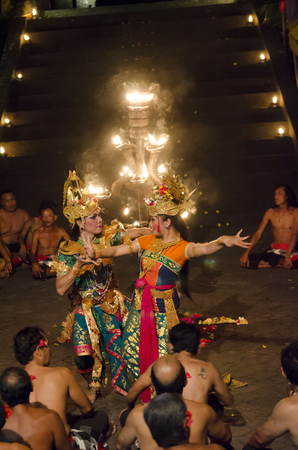 BALI, INDONESIA - JUNE 14: Presentation of traditional balinese Women Kecak Fire Dance on JUNE 14, 2014 on Bali. Kecak (also known as Ramayana Monkey Chant) is very popular cultural show on Bali. Editorial