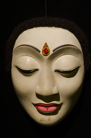 Traditional Balinese mask on a black background. photo