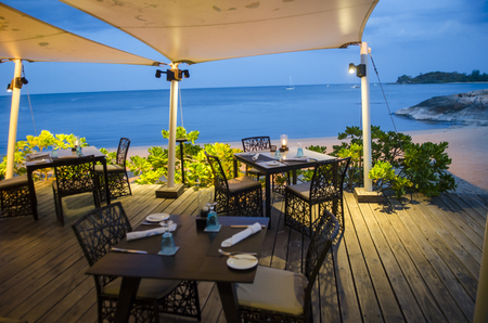 Table setting at beach restaurant in twilight time.