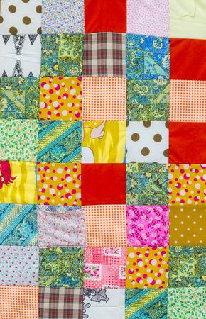 Background of colorful patchwork fabrics Standard-Bild