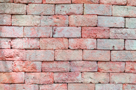 vignetted: brick wall texture grunge background with vignetted corners of interior Stock Photo