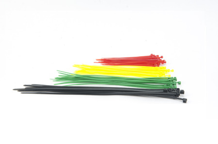 zip tie: cable plastic tie isolated on white background Stock Photo