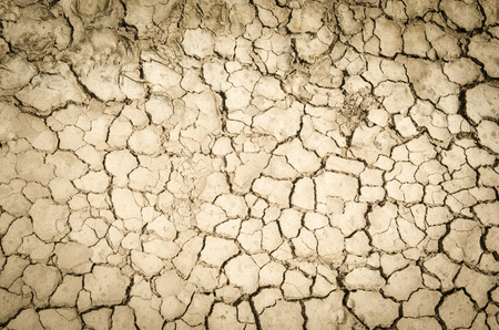 vignetted: Crack soil on dry season, Global worming effect with vignetted corners Stock Photo
