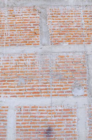red brick wall: red brick wall texture grunge background with vignetted corners of interior Stock Photo