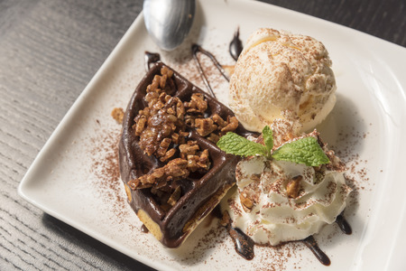 A slice of rich chocolate cake with ice cream